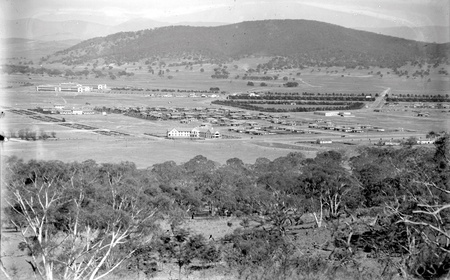 Braddon and Civic Centre from Mt Ainslie. Ainslie Hotel in the centre.Black Mountain at the rear