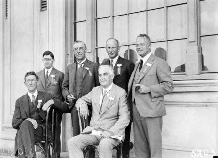 Second Conference of 65th District of Rotary. Delegates outside Albert Hall. Six executive committee members including Sir Robert Garran.