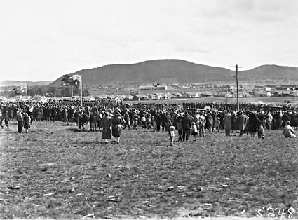 Anzac Day 1929 , Australian War Memorial site, Canberra - Spectators watching the March Past, Civic Centre in the background