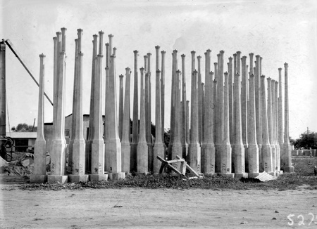 Concrete lamp standards in storage yard at Kingston Power Station yard