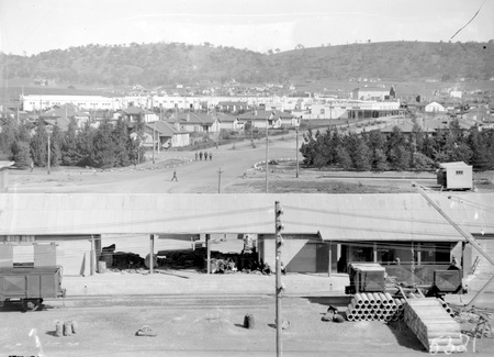 Kingston from industrial area near intersection of Giles Street and Wentworth Avenue. Concrete pipes being loaded into rail wagons