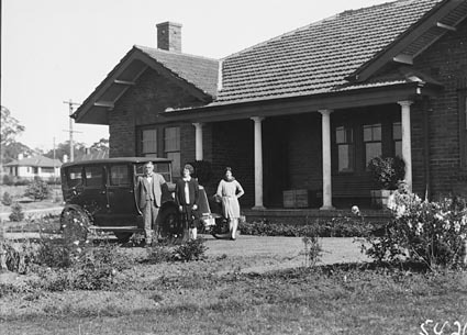 Senator  CW Marr with wife, daughter and Armstrong Siddeley  motor car in front of  their home at the corner of Dominion Circuit and Barkley Crescent