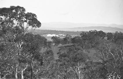 Distant view of Parliament House from vicinity of Black Mountain