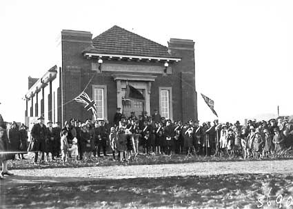 Opening of Salvation Army Hall by Sir John Butters and dedicated by Commissioner Charles Sowton on 6 July 1929 at Eloura and Fawkner Streets,  Braddon - bands and spectators