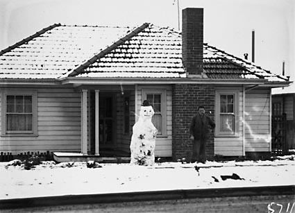 Record fall of snow - House with snowman in Ainslie