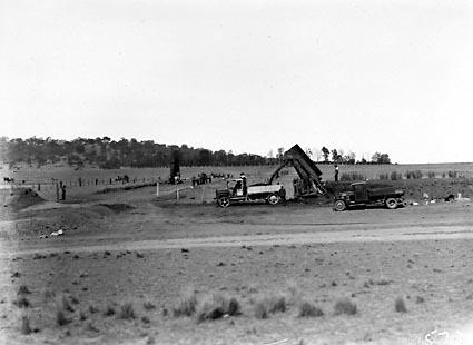Ditch Digger loading trucks