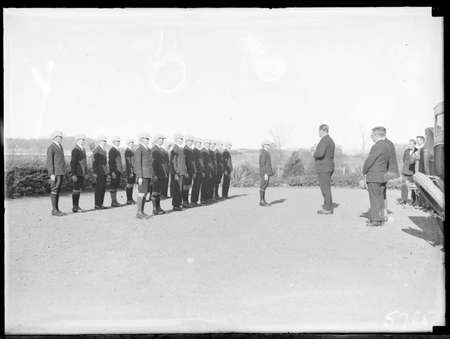 School boys sporting teams being addressed by Sir John Butters in front of Acton Offices.