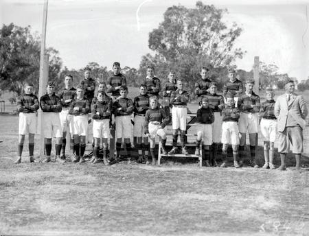 Group photograph of a school football team.