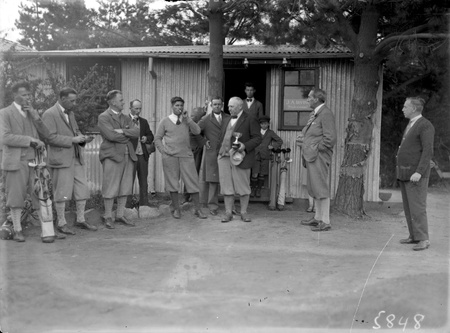 Right Honourable Stanley Melbourne Bruce with a group of golfers at the Royal Canberra Golf Club.