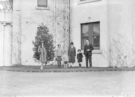 Sir John Butters and family outside Canberra House, Acton.