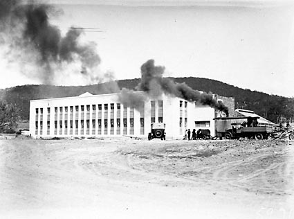 CSIR Offices and Laboratories Building with steam shovel and trucks. Clunies Ross Street, Black Mountain