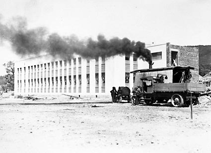 CSIR Offices and Laboratories Building with steam shovel and truck. Clunies Ross Street, Black Mountain