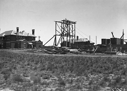 Commencement of construction of St. Andrews Presbyterian Church, St Andrews House [the Manse] on the left,  State Circle,  Forrest