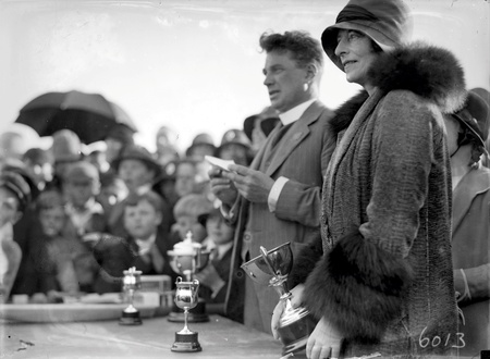 Reverend Doctor William John Edwards, Headmaster of Canberra Grammar School with Lady Stonehaven, wife of  the Govenor General with trophies for  the School  Sports Day at Manuka Oval