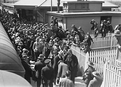 Arrival of Mr  J. H. Scullin newly elected Prime Minister at Canberra  railway station with welcoming crowds