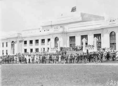 Armistice Day Ceremony with the Royal Military College Cadets on parade in front of Parliament House with spectators. View from Parkes Place.
