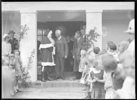 Santa Clause with Headmaster and children at Telopea Park School, New South Wales Crescent, Barton.