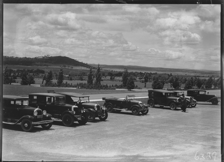 Motor cars outside Parliament House. Mt. Pleasant in background.