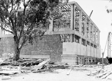 Australian Institute of Anatomy under construction. Fitting the sandstone finish. McCoy Circle, Acton