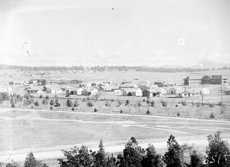 View towards Brassey House across Telopea Park from Kingston Power Station. Telopea Park School on the left, being built.