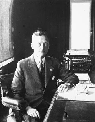 Hon TW White, Minister for Trade and Customs, in his office