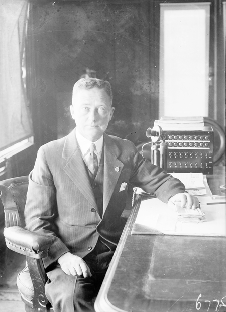 Hon TW White, Minister for Trade and Customs, in his office.