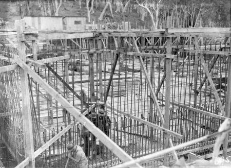 Excavation for Black Mountain reservoir, showing steel reinforcement and concrete form work.