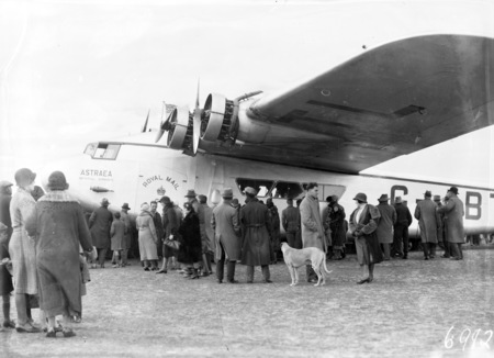 Visit of Imperial Airways Airliner ASTRAEA on a survey flight for proposed air mail service with dog and spectators.