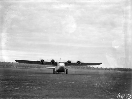 Visit of Imperial Airways Airliner ASTRAEA on a survey flight for proposed air mail service. Aircraft taxing on Duntroon landing ground. Aircraft weighs 10 tons laden, holds 17 passengers, 14 feet high, wing span 90 feet, 71.5 feet long, is a high wing unbraced monoplane with four Armstrong Siddeley double Mongoose air cooled radial engines of 340 horse power. Cruising speed is 118 MPH and maximum speed of 150 MPH and has a fuel range for 7 hours at full load.