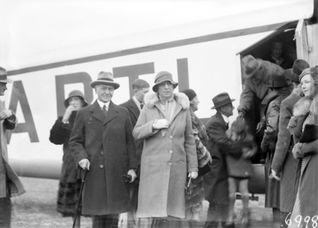 Visit of Imperial Airways Airliner ASTRAEA on a survey flight for proposed air mail service. Sir Isaac and Lady Isaacs beside the aircraft.