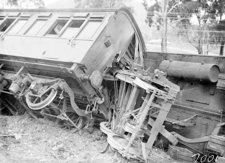 Derailment of the Albury Mail Train at Bowning at 4.30 AM. Train was travelling at 35 MPH and 6 carriages were derailed. 6 passengers were injured. One of the derailed bogies.
