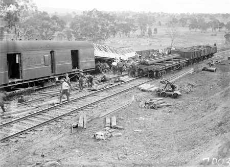 Derailment of the Albury Mail Train at Bowning at 4.30 AM. Train was travelling at 35 MPH and 6 carriages were derailed. 6 passengers were injured. Rescue waggons beside the derailed carriages.