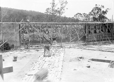 Black Mountain Reservoir, under construction. Form work and reinforcement for concreting being erected.