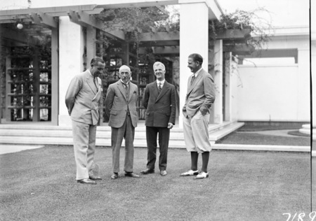Group in Parliament House courtyard including Right Hon W M Hughes and Right Hon J H Scullin with two visiting American golfers.