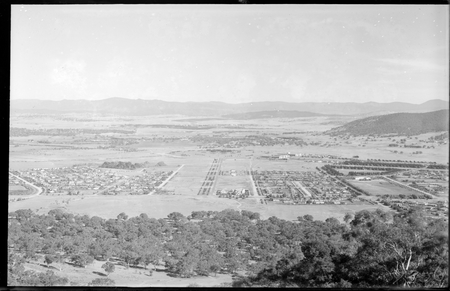 Part of Reid and Braddon from Mt Ainslie. Civic Centre and City Hill in centre. Ainslie Hotel in front.