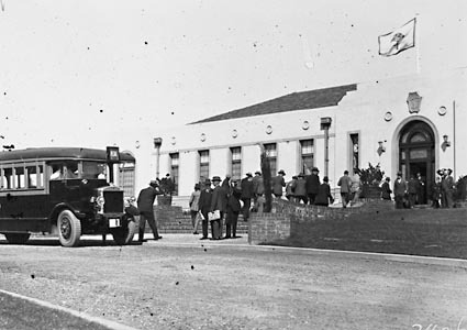 Motor bus delivering passengers to Australian Forestry School - possibly for a Forestry Conference. Banks Street, Yarralumla