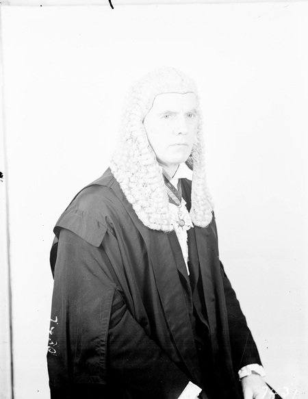 The Honourable GJ Bell in Speakers Robes of Office.
