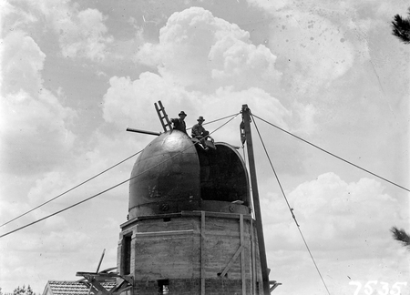 Workmen on the solar tower at the Commonwealth Solar Observatory on Mt Stromlo.