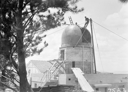 Workmen on the dome over the Farnham telescope, Commonwealth Solar Observatory, Mt Stromlo.