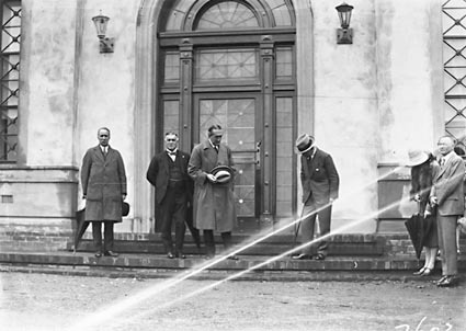 Opening of Church of England Mens Society -Prime Minister , Right Honourable SM Bruce, Sir George Pearce and Governor-General, Lord Stonehaven, at entrance to  the Australian Forestry School, Banks St., Yarralumla