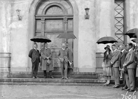 Opening of Church of England Mens Society. Prime Minister, Right Honourable SM Bruce, Sir George Pearce and Governor-General, Lord Stonehaven speaking at entrance to the Australian Forestry School, Banks St., Yarralumla.
