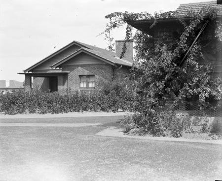 Brick cottage and gardens.