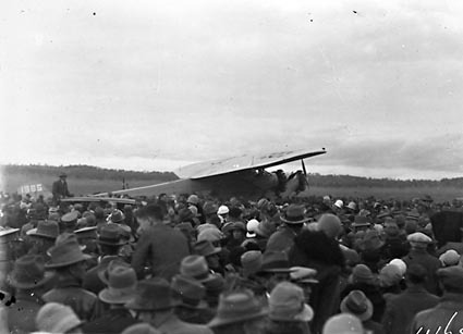 Kingsford Smith's Fokker Trimotor type FV111 B/3M aircraft, Southern Cross and crowd at the air force landing ground near Duntroon (now Fairburn)