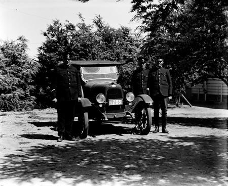 Three Policemen with motor car.