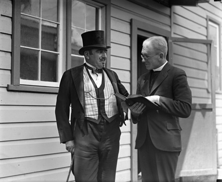 Two actors in costume in front of the bachelors quarters, published in Canberra Community News, page 6, March 1927.
