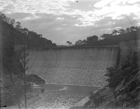 Cotter Dam wall, over flowing into the stilling pond.
