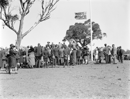Anzac Day, 1927. View of the crowd at the ceremony showing flag at half-mast.