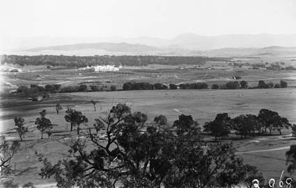 View of Parliament House and East Block from Russell Hill showing farm buildings near river