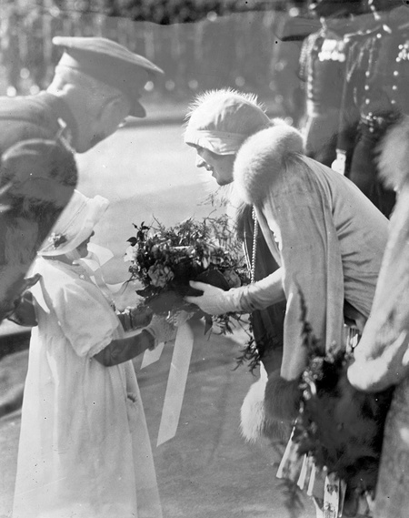 Royal Visit, May 1927. The Duchess of York receiving a bouquet from a young girl (Gwen Pinner).