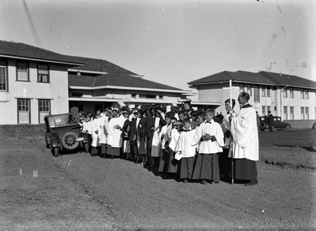 Royal Visit, May 1927. Group of clergy and choir lined up at the Hotel Canberra for dedication of site for the Anglican Cathedral.